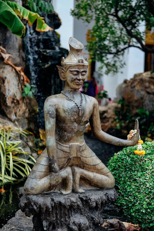 A buddah in the temple garden in Bangkok