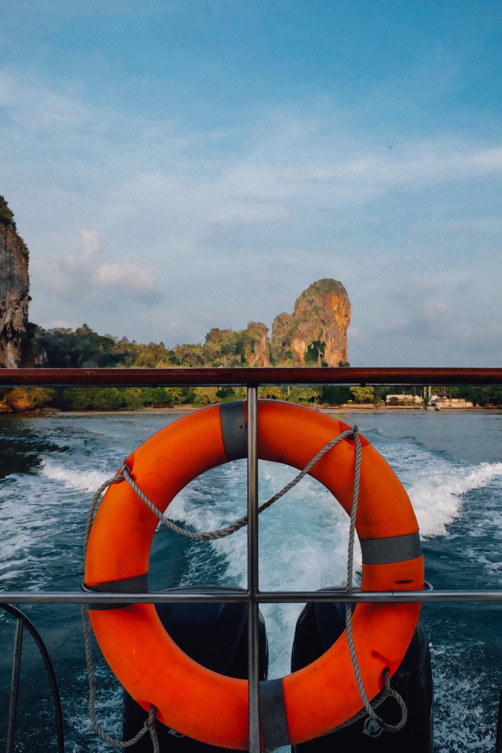 "View from the back of the boat when leaving the Rayavadee Resort in Krabi. Travel photography and guide by © Natasha Lequepeys for ""And Then I Met Yoko"". #thailand #seasia #travelguide #photoblog #travelblog #travelphotography #landscapephotography #travelitinerary #fujifilm #krabi #beachvacation #honeymoon #boat #rayavadee #resort #luxury #luxurytravel #spa #travelblogger #travel"