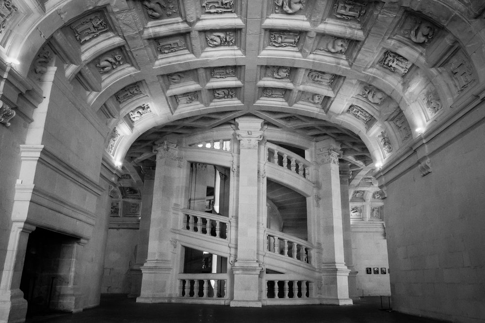 """Interior double staircase in the Château de Chambord - Travel photography and guide by © Natasha Lequepeys for """"And Then I Met Yoko"""". #loirevalley #france #travelguide #travelphotography #valdeloire"""