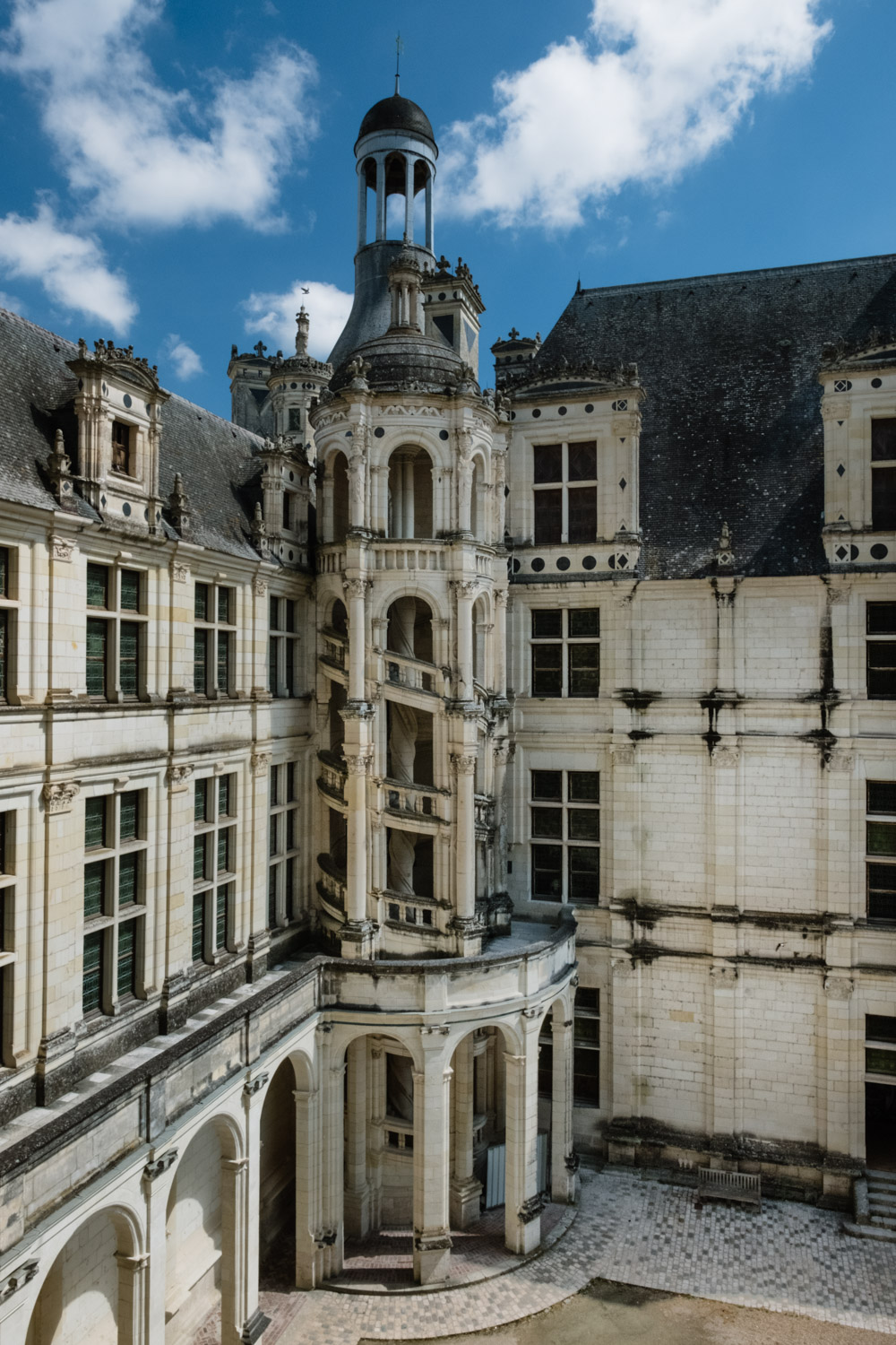 """Exterior staircase in the Château de Chambord - Travel photography and guide by © Natasha Lequepeys for """"And Then I Met Yoko"""". #loirevalley #france #travelguide #travelphotography #valdeloire"""