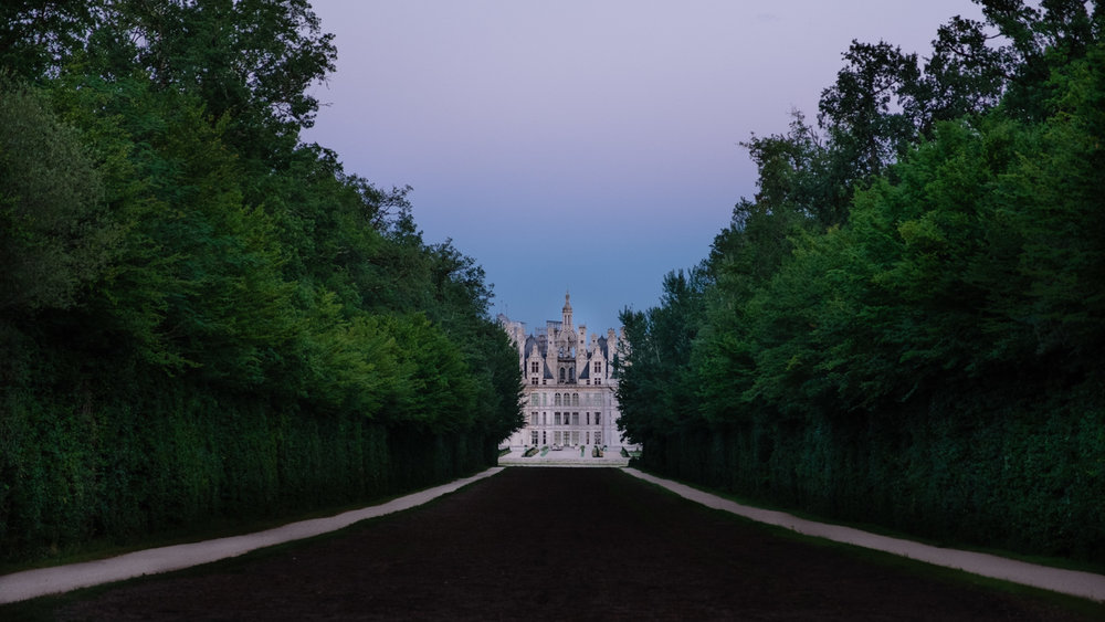 Chambord at the end of the path from the garden