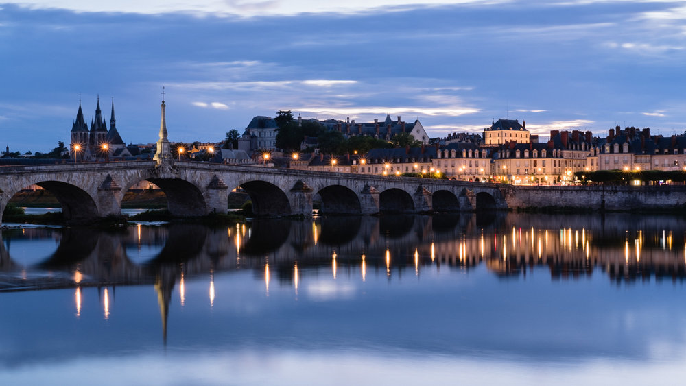 The city of Blois at night during blue hour
