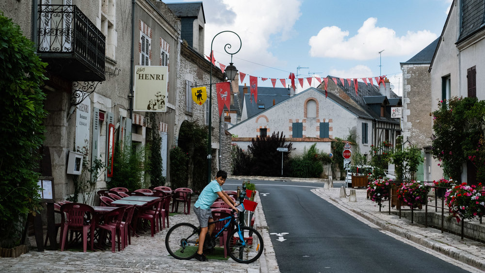 A boy on his bike in the town of Beaugency