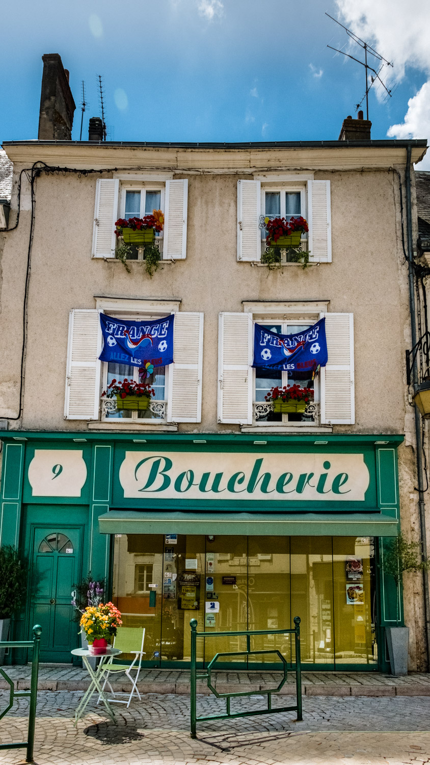 French football flags above a boucherie in Beaugency