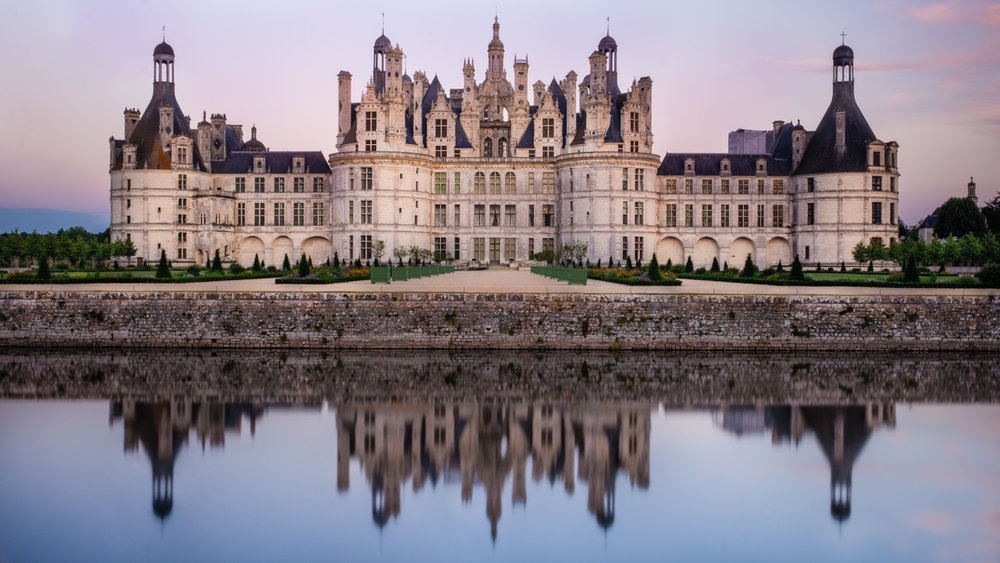 """Château de Chambord at sunset, Loire Valley. Travel photography and guide by © Natasha Lequepeys for """"And Then I Met Yoko"""". #loirevalley #france #travelguide #photoblog #travelblog #travelphotography #landscapephotography #architecturephotography #travelitinerary #fujifilm #valdeloire #loire #chambord #chenonceau #cheverny #chaumont #chateau #castles #discoverfrance #honeymoondestination"""
