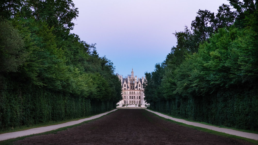 """Chateau de Chambord at sunset - Travel photography and guide by © Natasha Lequepeys for """"And Then I Met Yoko"""". #loirevalley #france #travelguide #travelphotography #valdeloire #chambord"""