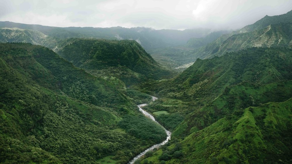 Aerial view of a river running through a valley
