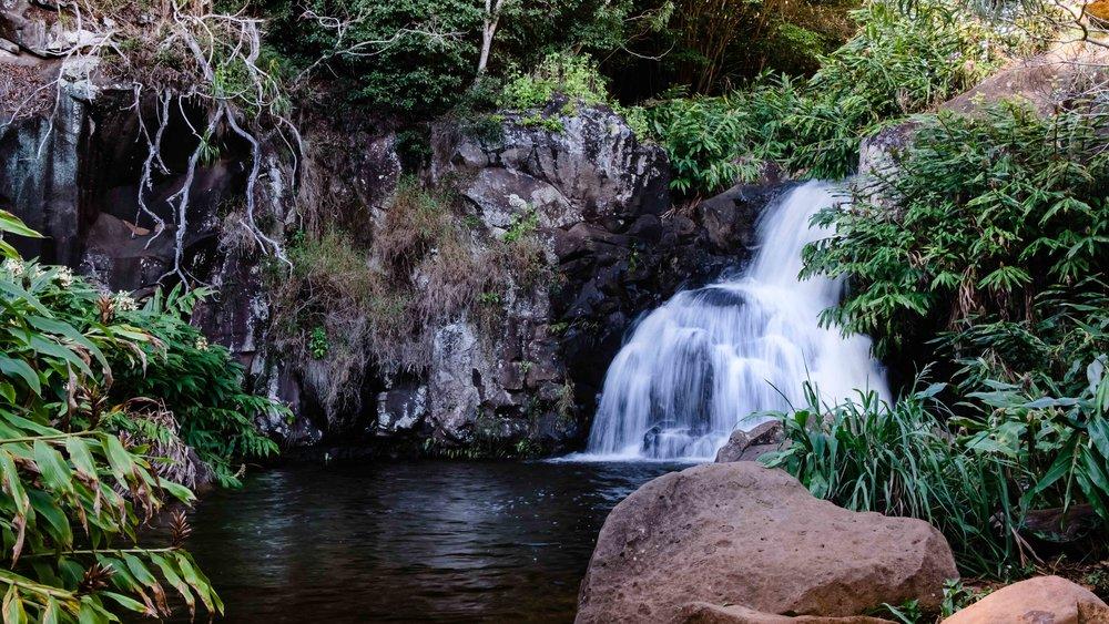 A waterfall along the Waipo'o Falls Trail hike