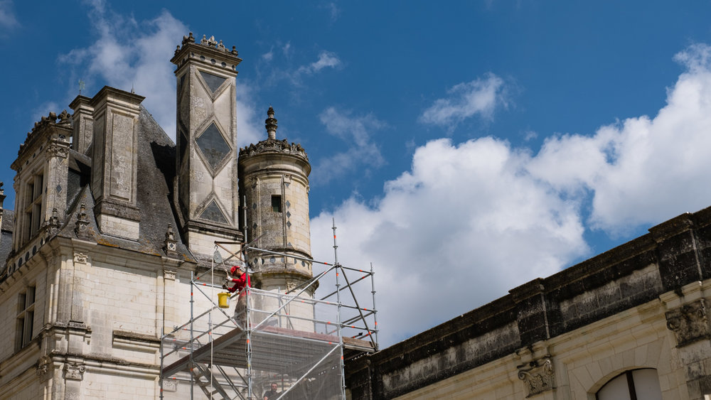 A man works on the restoration at Château de Chambord