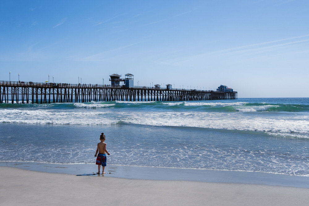 "A little boy at the Oceanside Beach - San Diego travel guide by ""And Then I Met Yoko"". Photography by Natasha Lequepeys #travelphotography #travelblog #sandiego"