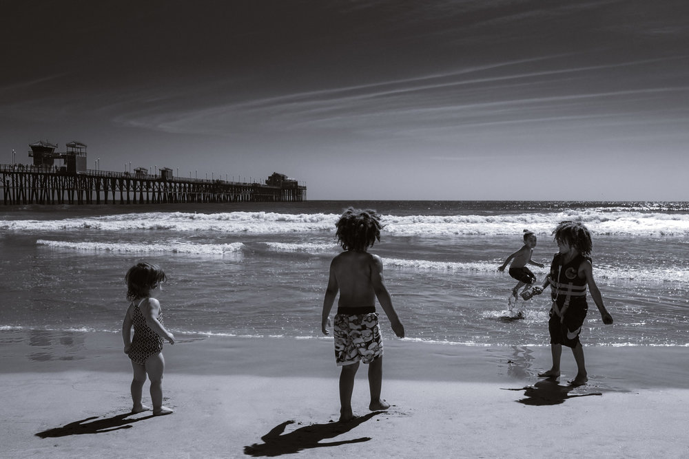 "Kids playing at the Oceanside Beach - San Diego travel guide by ""And Then I Met Yoko"". Photography by Natasha Lequepeys #travelphotography #travelblog #sandiego"