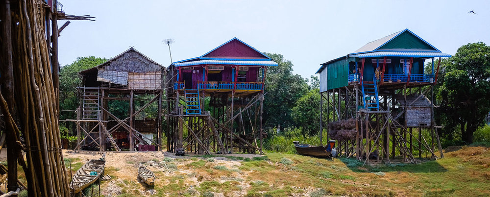 "Stilt houses during dry season in the backcountry, Siem Reap- travel photography and guide by © Natasha Lequepeys for ""And Then I Met Yoko"". #siemreap #angkorwat #taprohm #travelguide #travelblog #travelitinerary #itinerary #siemreapitinerary #seasia #cambodia #travelcambodia #travelsiemreap #photoblog #travelblogger #travelphotography #landscapephotography #fujifilm #temples #siemreapprivatetour #atv"