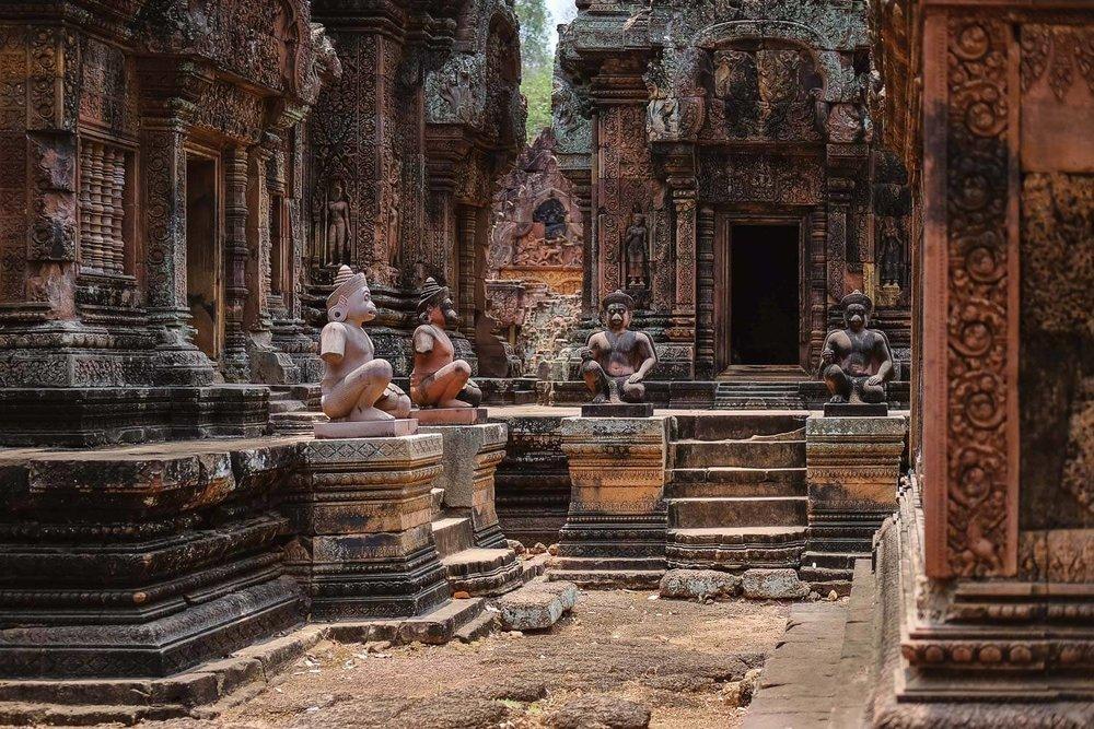 Monkey statues inside Ta Prohm Temple