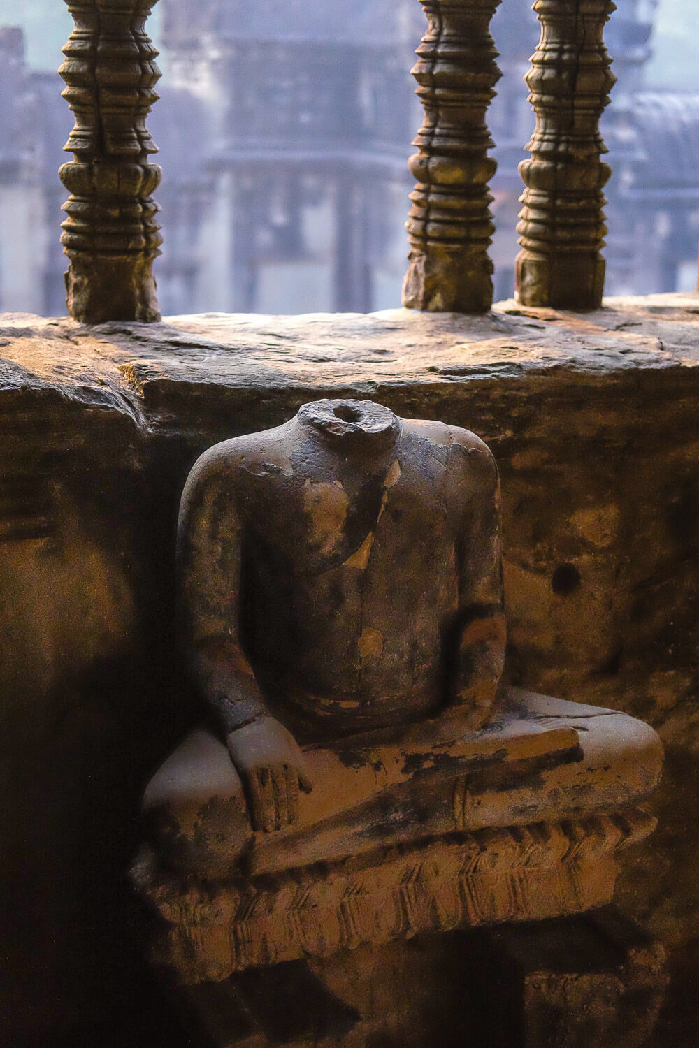 A Buddha statue with it's head removed.     #siemreap #angkorwat #travelguide #travelblog #siemreapitinerary #cambodia #travelphotography #landscapephotography #fujifilm #siemreapprivatetour