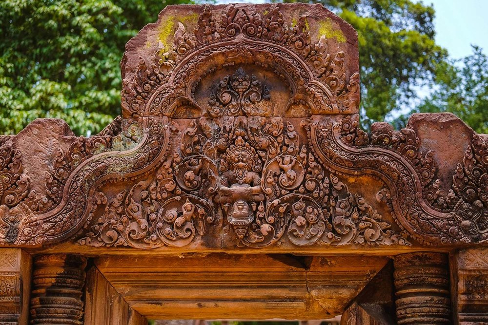 "Intricate carvings above a doorway in Banteay Srei, Siem Reap. Travel photography and guide by © Natasha Lequepeys for ""And Then I Met Yoko"". #siemreap #banteaysrei #angkorwat #travelguide #travelblog #travelitinerary #itinerary #siemreapitinerary #seasia #cambodia #travelcambodia #travelsiemreap #photoblog #travelblogger #travelphotography #landscapephotography #fujifilm #temples #siemreapprivatetour #atv"