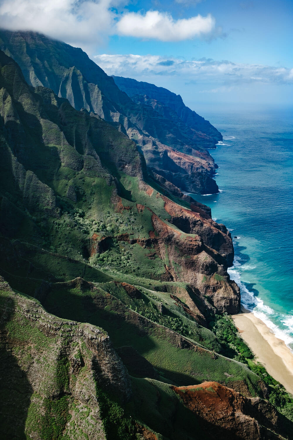 """Kauai coastline from the helicopter. Travel photography and guide by © Natasha Lequepeys for """"And Then I Met Yoko"""". #hawaii #travelguide #photoblog #travelblog #landscapephotography #fujifilm"""