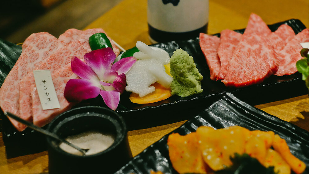 Yakiniku is a type of restaurant where you grill your own meat. General rule of thumb, the more fatty white parts in the meat, the tastier it is.