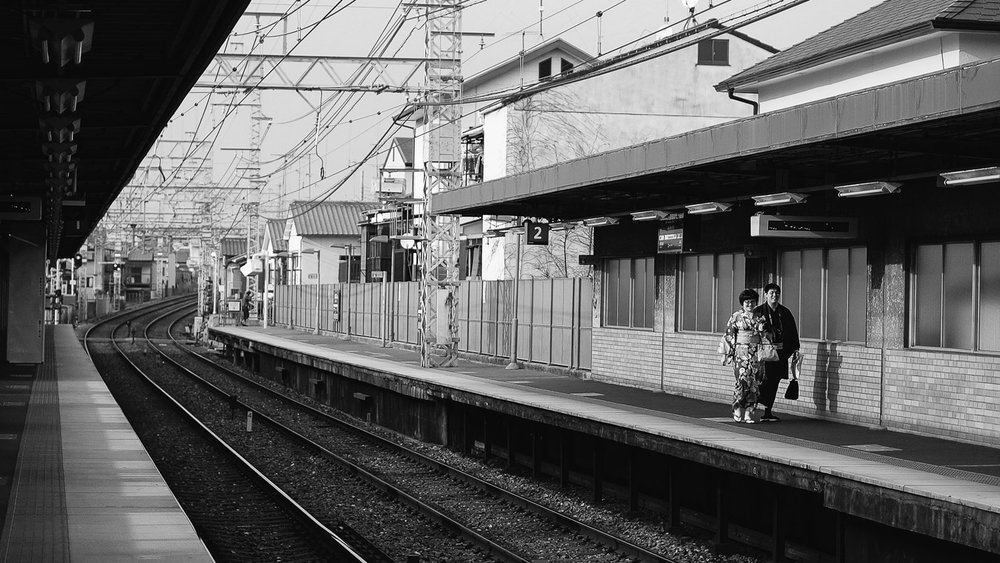 "A Japanese couple waiting for their train in Nara. Travel photography and guide by © Natasha Lequepeys for ""And Then I Met Yoko"". #japan #japanitinerary #tokyo #osaka #travelblog #travelphotography #landscapephotography #travelitinerary #fujifilm #kyoto #nara #oaska #travelguide #asia #foodphotography #japantravel #japanfood #ryokan #cherryblossom #springtravel"