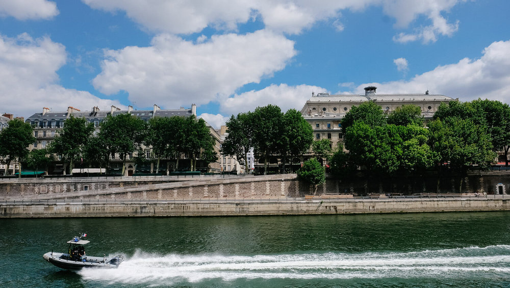"""Speedboat on the Seine River, Paris. Travel photography and guide by © Natasha Lequepeys for """"And Then I Met Yoko"""". #paris #paristravel #photoblog #travelguide #france #parisitinerary #parishighlights #parissights #travelblog #travelphotography #landscapephotography #travelitinerary #fujifilm #paristravelguide #architecturephotography #europe #travelblogger #wanderlust #explore #travel"""