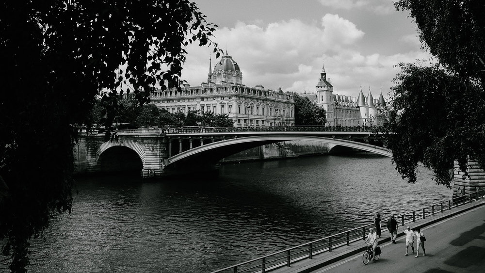 """People walking along the Seine, Paris. Travel photography and guide by © Natasha Lequepeys for """"And Then I Met Yoko"""". #paristravel #photoblog #travelguide #france #parisitinerary"""