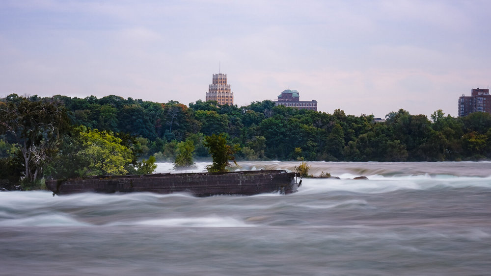 "The abandoned scow shipwreck in the upper rapids, Niagara Falls. Travel photography and guide by © Natasha Lequepeys for ""And Then I Met Yoko"". #niagara #niagarafalls #ontario #canada #discoverontario #niagaraonthelake #travelguide #photoblog #travelblog #travelphotography #landscapephotography #travelitinerary #fujifilm #shipwreck #ontariohistory #longexposure #notl #travelblogger #niagaraitinerary #niagaraphotography"