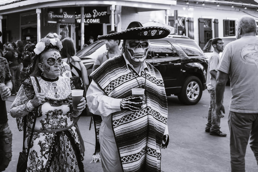 "Couple costume on Halloween. Travel photography and guide by © Natasha Lequepeys for ""And Then I Met Yoko"". #neworleans #nola #travelguide #photoblog #travelblog #travelphotography #travelitinerary #fujifilm #usa #visitnola #weekendgetaway #travel #neworleans3dayitinerary #streetphotography #bnw #halloween #costume #couplecostume #dayofthedead #blackandwhitephotography"