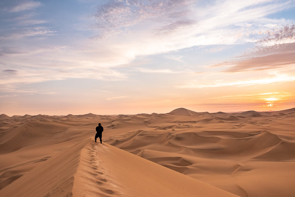 """Travel Guide to Ica and Huacachina, Peru. Experience vast sand dunes, thrilling buggy rides and great food and wine. Travel photography and guide by © Natasha Lequepeys for """"And Then I Met Yoko"""". #peru #ica #huacachina #photoblog #travelblog #travelphotography #landscapephotography #travelitinerary #fujifilm #sanddunes #desert #sunset #sandboarding #streetfood #foodphotography #oasis #backpacker #winery #travel #huacachinatours"""