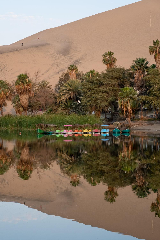 "Huacachina oasis, Ica, Peru. Travel photography and guide by © Natasha Lequepeys for ""And Then I Met Yoko"". #photoblog #travelblog #landscapephotography #fujifilm #blogger #reflection"