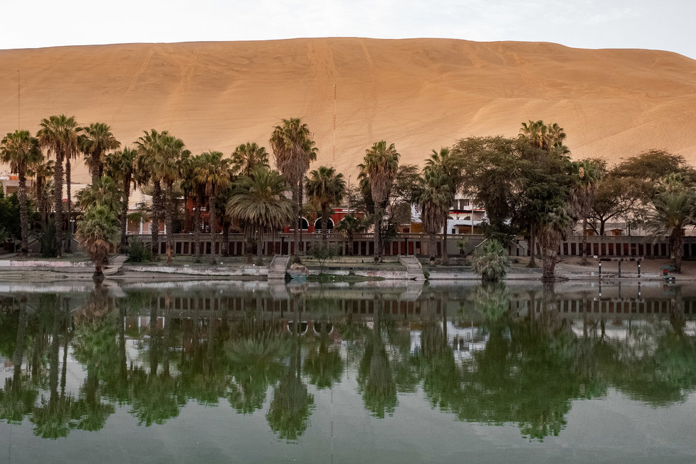 """Huacachina Oasis in Ica, Peru. Travel photography and guide by © Natasha Lequepeys for """"And Then I Met Yoko"""". #photoblog #travelblog #landscapephotography #fujifilm #blogger"""