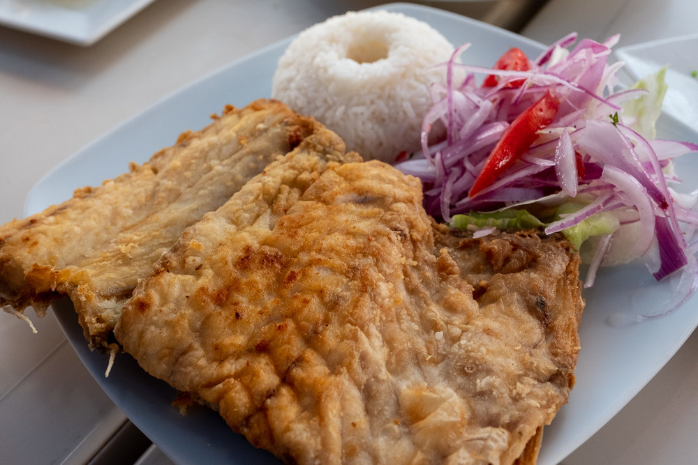 """Fried fish at Cevicheria Los Mariscos, Ica. Travel photography and guide by © Natasha Lequepeys for """"And Then I Met Yoko"""". #photoblog #peru #travelblog #foodphotography #fujifilm #blogger #foodie"""