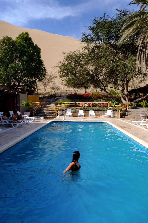 "Hotel El Huacachinero in Huacachina, Peru. Travel photography and guide by © Natasha Lequepeys for ""And Then I Met Yoko"". #peru #ica #huacachina #photoblog #travelblog #travelphotography #landscapephotography #travelitinerary #fujifilm #sanddunes #desert #hotel #sandboarding #pool #luxuryliving #oasis #relaxation #travelgood #travel #huacachinatours"