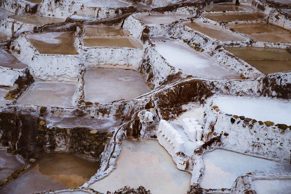 "The Maras Salt Ponds in The Sacred Valley, Peru. Travel photography and guide by © Natasha Lequepeys for ""And Then I Met Yoko"". #travelguide #photoblog #fujifilm #machupicchu #ValleSagrado #travel"