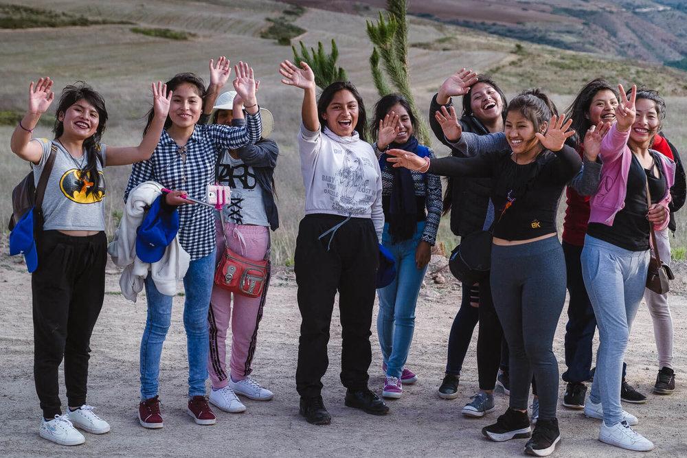 "Girls saying hi, The Sacred Valley, Peru. Travel photography and guide by © Natasha Lequepeys for ""And Then I Met Yoko"". #travelguide #photoblog #fujifilm #machupicchu #sacredvalleyitinerary #travel"