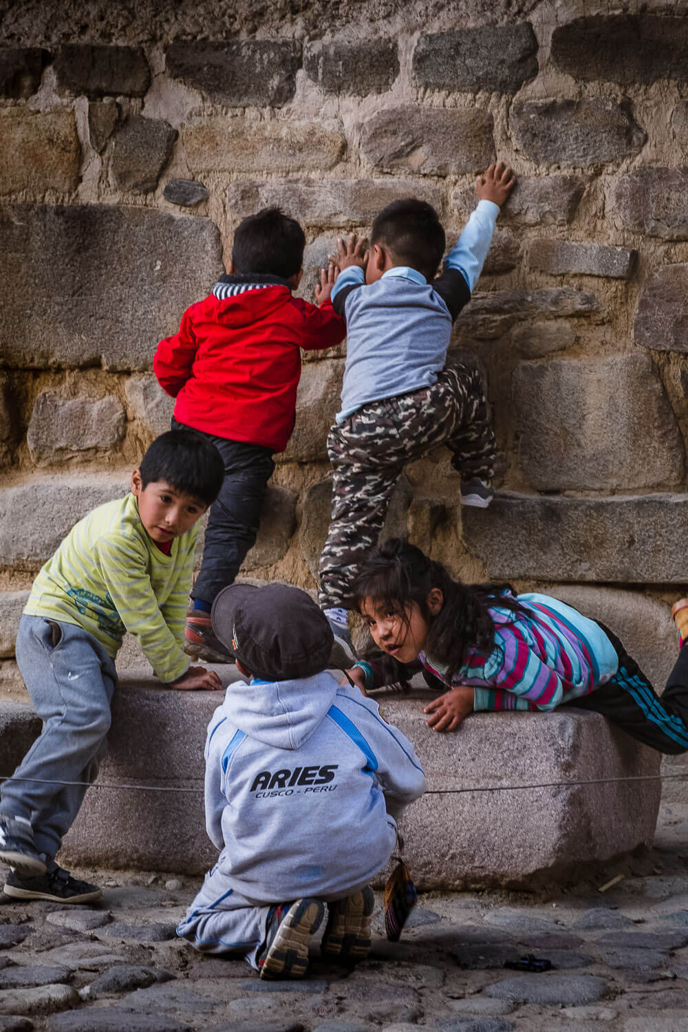 """Kids playing in The Sacred Valley, Peru. Travel photography and guide by © Natasha Lequepeys for """"And Then I Met Yoko"""". #travelguide #photoblog #fujifilm #machupicchu #sacredvalleyitinerary"""