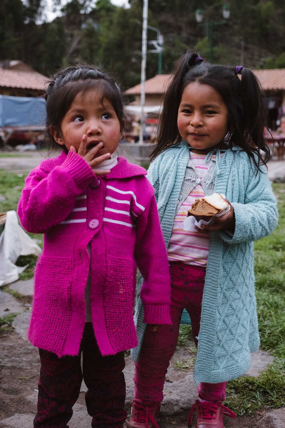 "Girls enjoying a snack in Waqch'i. Travel photography and guide by © Natasha Lequepeys for ""And Then I Met Yoko"". #peru #sacredvalley #cusco #laketiticaca #belmondandeanexplorer #perurail #perutrain #luxurytravel #sleepertrain #photoblog #travelblog #travelphotography #fujifilm #andes #travel #travelperu #cuscotolaketiticaca #spiritofthelake #belmond #puno #southamerica"