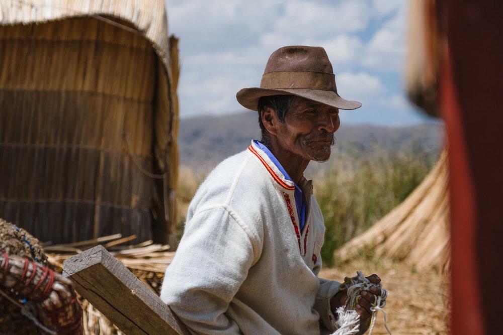 "A man prepares the boat on Uros Island. Travel photography and guide by © Natasha Lequepeys for ""And Then I Met Yoko"". #peru #laketiticaca #amantani #taquile #homestay #culturalexperience #photoblog #travelblog #travelphotography #fujifilm #travel #travelperu #southamerica #allwaystravel #laketiticacaitinerary #puno #uros #floatingislands #pachamama #pachatata"