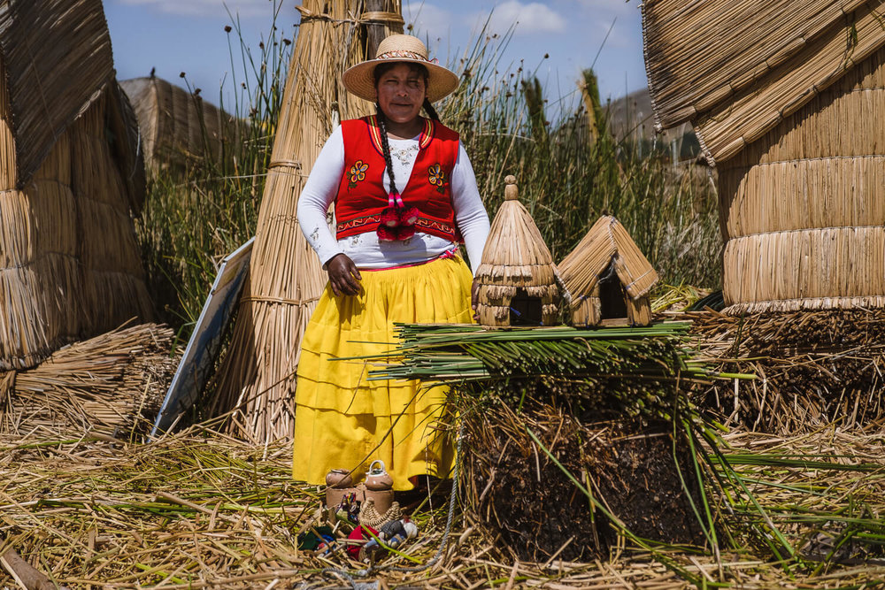 """Woman gives a demonstration on how the floating islands are created. Travel photography and guide by © Natasha Lequepeys for """"And Then I Met Yoko"""". #peru #laketiticaca #amantani #taquile #homestay #culturalexperience #photoblog #travelblog #travelphotography #fujifilm #travel #travelperu #southamerica #allwaystravel #laketiticacaitinerary #puno #uros #floatingislands #pachamama #pachatata"""