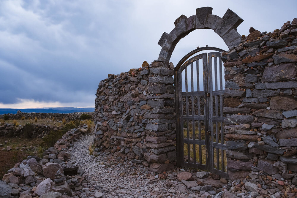 "The stone gate at Pachamama, Amantani Island. Travel photography and guide by © Natasha Lequepeys for ""And Then I Met Yoko"". #peru #laketiticaca #amantani #taquile #homestay #culturalexperience #photoblog #travelblog #travelphotography #fujifilm #travel #travelperu #southamerica #allwaystravel #laketiticacaitinerary #puno #uros #floatingislands #pachamama #pachatata"