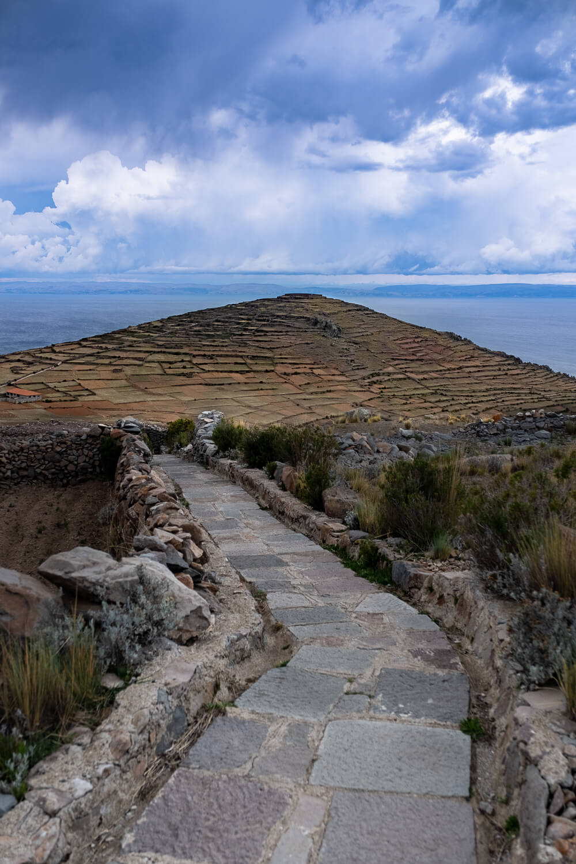 "The path to Pachamama on Amantani Island. Travel photography and guide by © Natasha Lequepeys for ""And Then I Met Yoko"". #peru #laketiticaca #amantani #taquile #homestay #culturalexperience #photoblog #travelblog #travelphotography #fujifilm #travel #travelperu #southamerica #allwaystravel #laketiticacaitinerary #puno #uros #floatingislands #pachamama #pachatata"