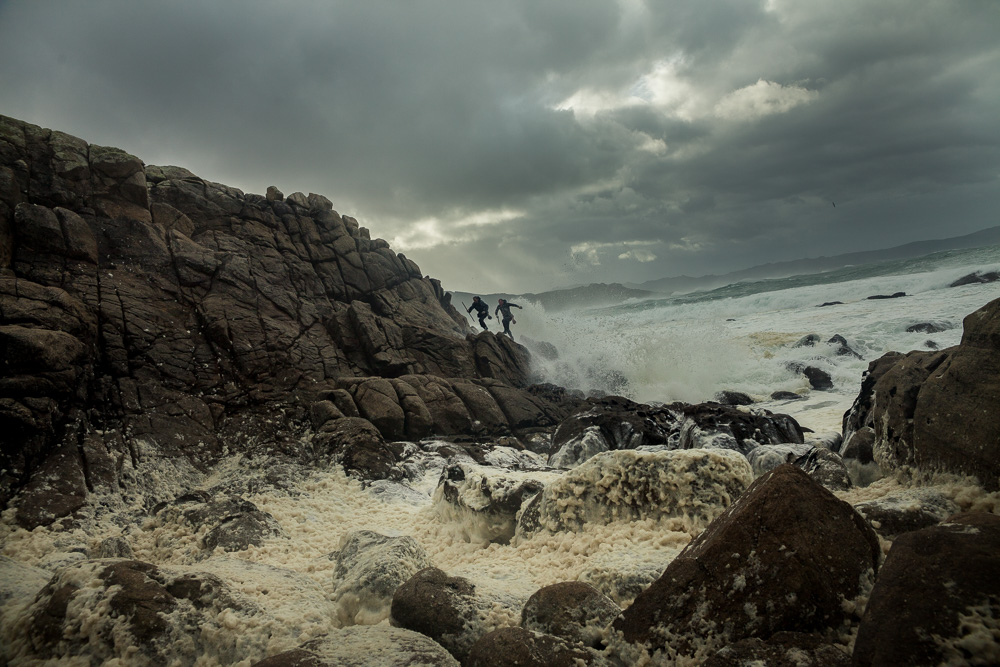 December 15, 2011 - Laxe (La Coruña). Juan and Joaquin, two of younger and skilled percebeiros, try to escape from a unexpected wave. Despite the bad condition of the sea, they decided to go out and harvest anyway. © Thomas Cristofoletti 2011