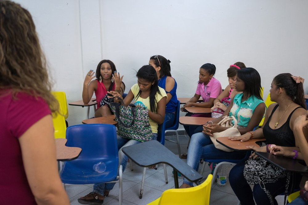 "CARTAGENA, COLOMBIA - FEBRUARY 26, 2015: Tania Duarte, a 23-year-old philosophy student and trans activist for the LGBT rights group Caribe Afirmativo, during a class at the university. She is also the first trans person to study at Cartagena University. ""This is a racist and machista city,"" she explains. ""We are still seen as sick, socially maladjusted, and with psychological problems. And this goes hand in hand with the stereotype that we can only be prostitutes or hairdressers."" When she is not studying, Duarte works for Caribe Afirmativo, which was founded in 2007 after the violent murder of the college professor and LGBT rights activist Rolando Peréz. The group documents cases of abuse against the LGBT population, trains law enforcement and policy officials on human rights, and advocates against impunity for those who commit crimes against this population. ""I wish that there were more [trans persons] who could pursue a higher education like I am, and who could study medicine or law, or become an engineer,"" says Duarte. Throughout Latin America and the Caribbean and around the world, USAID works side by side with groups like Caribe Afirmativo to support human rights and dignity."