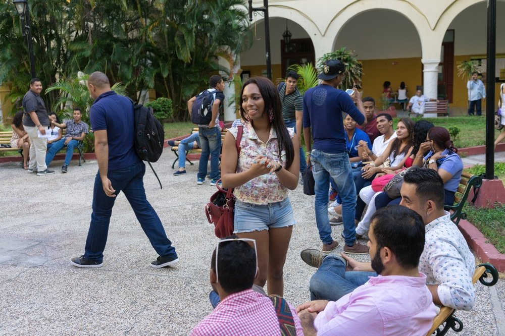 "CARTAGENA, COLOMBIA - FEBRUARY 26, 2015: Tania Duarte, a 23-year-old philosophy student and trans activist, talks with members of LGBT rights group Caribe Afirmativo. She is also the first trans person to study at Cartagena University. ""This is a racist and machista city,"" she explains. ""We are still seen as sick, socially maladjusted, and with psychological problems. And this goes hand in hand with the stereotype that we can only be prostitutes or hairdressers."" When she is not studying, Duarte works for Caribe Afirmativo, which was founded in 2007 after the violent murder of the college professor and LGBT rights activist Rolando Peréz. The group documents cases of abuse against the LGBT population, trains law enforcement and policy officials on human rights, and advocates against impunity for those who commit crimes against this population. ""I wish that there were more [trans persons] who could pursue a higher education like I am, and who could study medicine or law, or become an engineer,"" says Duarte. Throughout Latin America and the Caribbean and around the world, USAID works side by side with groups like Caribe Afirmativo to support human rights and dignity."