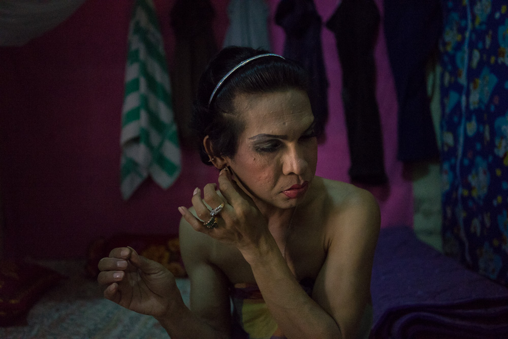 March 22, 2014 - Phnom Penh. A transgender sexworker prepares herself for the night. Contrary to what is happening in neighboring Thailand, the vast majority of transgender people in Cambodia do not have sufficient financial means to afford the cost for sex reassignment and spend a little money in hormonal pills of poor quality and of dubious origin. In many cases, the transition takes place with just a touch of mascara, a cheap foundation cream and some lipstick. © Thomas Cristofoletti / Ruom