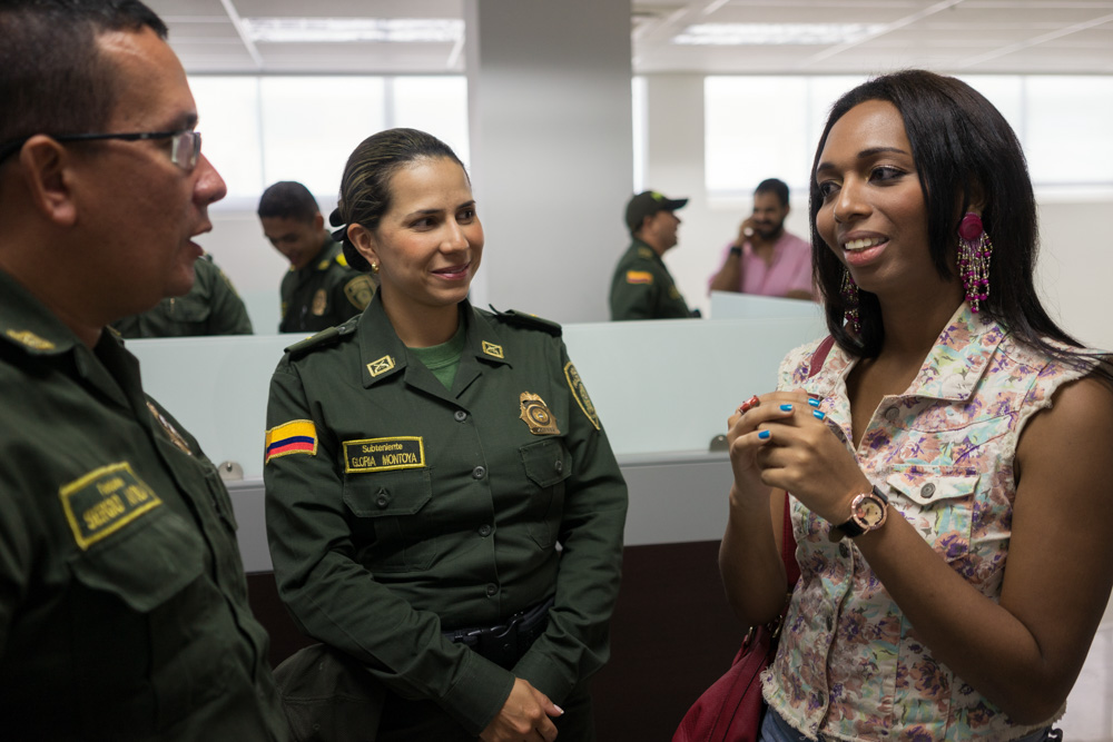 February 26, 2015 - Cartagena (Colombia). Tania Duarte, a student and trans activist for the group Caribe Afirmativo, talks with police officers in Cartagena on Colombia's Caribbean coast. With support from USAID, Caribe Afirmativo works with many sectors of society to try to improve the safety and well-being of members of the LGBT community, including improving their relationship with police. © Thomas Cristofoletti / Ruom for USAID