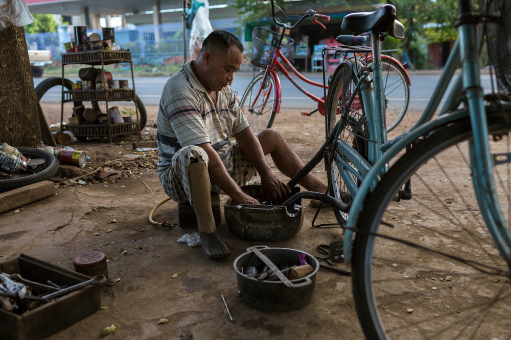 November 28, 2013 - Tropeang Cha village (Kompong Cham). Mr. Kan Sokhen (43) repairs a bicycle in his small repair shop. He was a soldier until 1987 when he lost a leg when he stop over a land mine. © Thomas Cristofoletti / Ruom