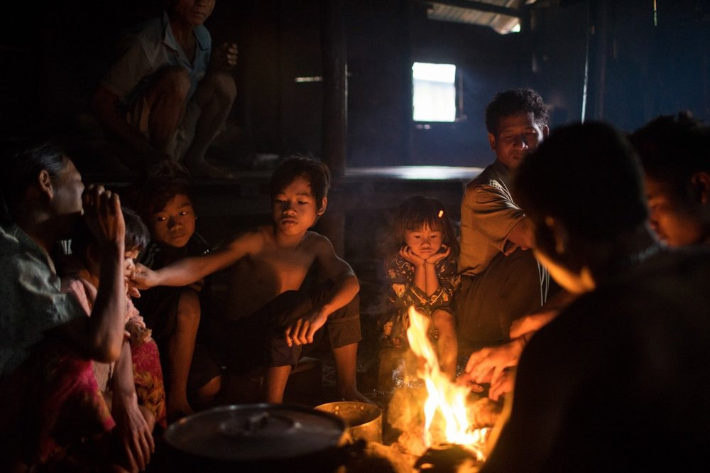 July 29, 2014 - Mondulkiri (Cambodia). A Phnong family sits around the fire inside a traditional house in Busra village. © Thomas Cristofoletti / Ruom