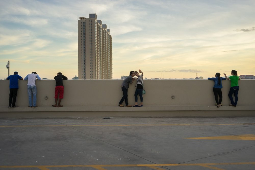 September 2, 2014 - Phnom Penh (Cambodia). Cambodian youths take a selfie on the roof of the recently built Aeon mall. © Thomas Cristofoletti / Ruom