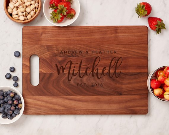 Customized Cutting Board - A lovely housewarming or holiday gift, these customizable,100% genuine wood cutting boards are handmade and personable (not to mention affordable at less than $30!). They can be found here.