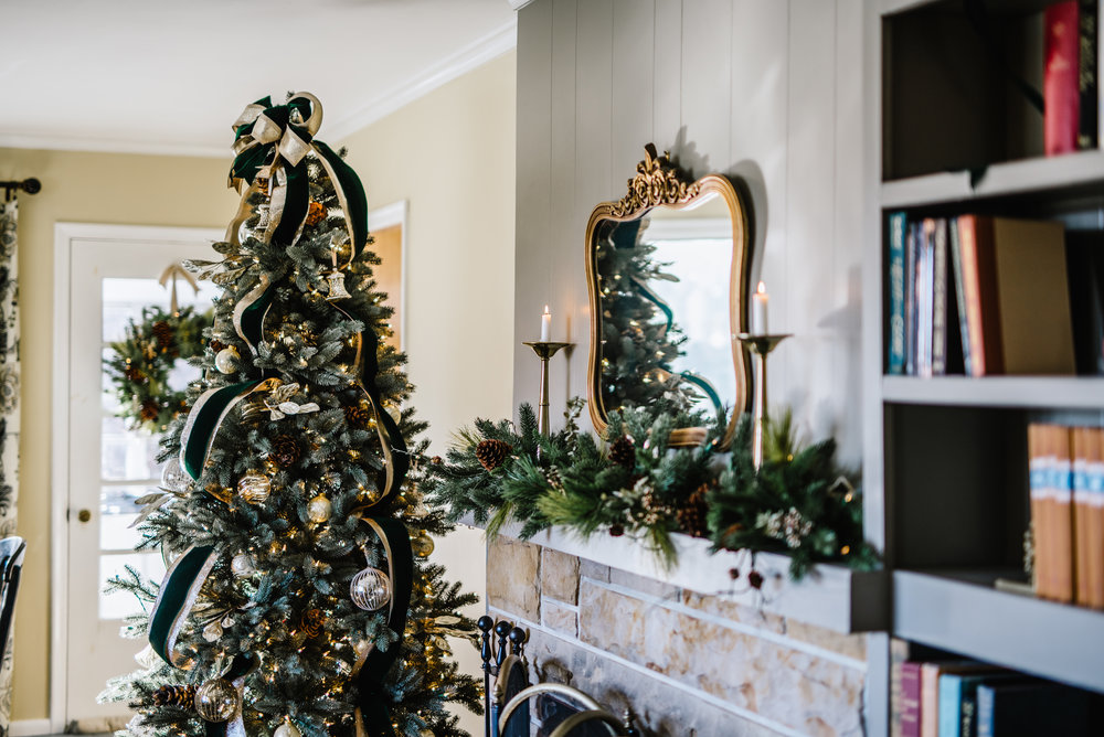 The Lutz living room all dressed up for the holidays.  Majestic Blue Spruce  tree,  Classic Fraser Fir garland and wreath . Photography by Rachel Cuthbert Photography