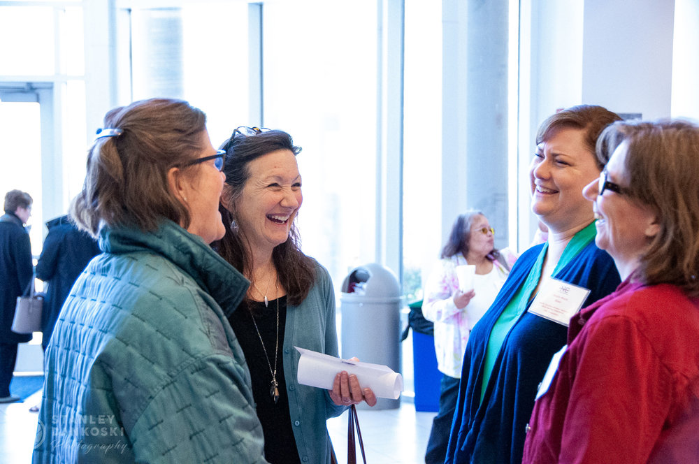 Jill McCorkle and Robin Muira chatting with others at the NCWN Spring Conference 2018.